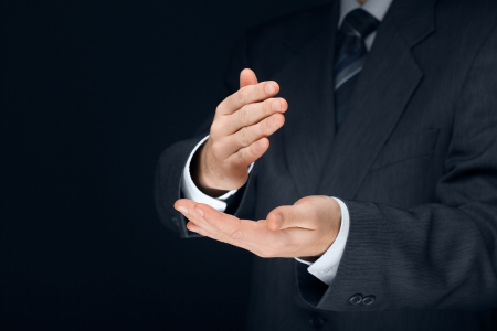 disclaim: Nonverbal communication. Stop it, deny, refuse and make crisp cut gesture of businessman.  Stock Photo