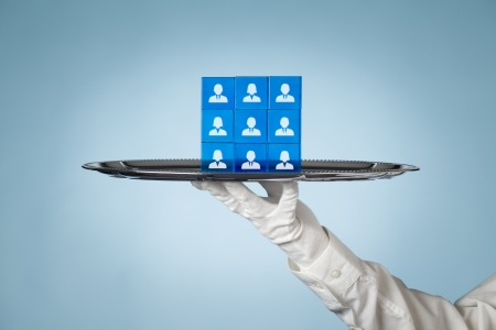 configuration: Human resources put on a tray. Team composition and team configuration concepts.  Stock Photo