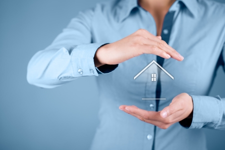 Property and security concept  Protecting gesture of woman and symbol of house