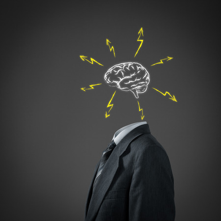 brain storm: Businessman without head just with sketched brain and flashes
