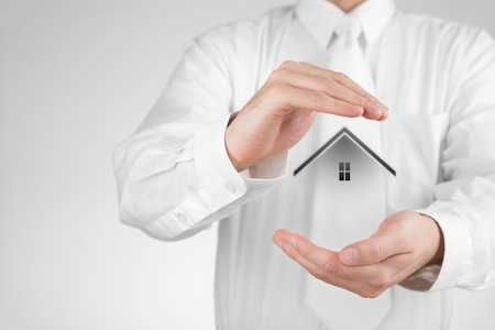 shielding: Property insurance and security concept  Protecting gesture of woman and symbol of house