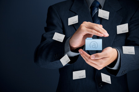 Protect mail against spam  junk mail  concept  Man with protective gesture, mail folder and spam in envelopes  photo