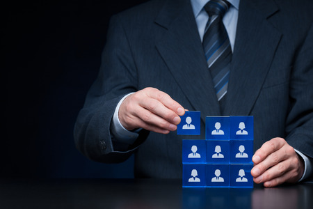 Human resources, social networking, assessment center concept, personal audit or CRM concept - recruiter complete team by one person. Employees are represented by blue glass cubes with icons. photo