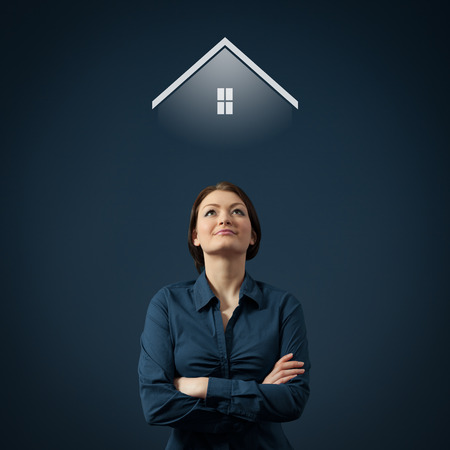 Woman dream about family house  Real estate agent think about house for sale  Stock Photo