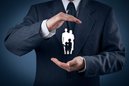 insurance services: Family life insurance, family services, family policy and supporting families concepts. Businessman with protective gesture and silhouette representing young family.