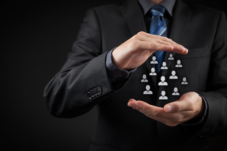 human capital: Customer care, care for employees, labor union, life insurance and marketing segmentation concepts. Protecting gesture of businessman or personnel and icons representing group of people. Stock Photo