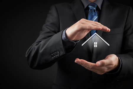 property agent: Property insurance and security concept. Protecting gesture of man and symbol of house.