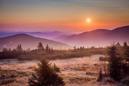 krkonose: Hills in morning haze and sunrise - Krkonose in Poland.