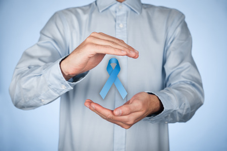 cure prevention: man with protective and support gesture and blue ribbon. Stock Photo