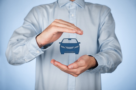 Businessman with protective gesture and icon of car. photo