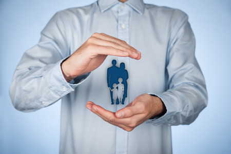family policy: Woman with protective gesture and silhouette representing young family.