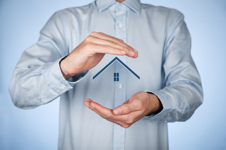 safety: Protecting gesture of man and symbol of house. Stock Photo