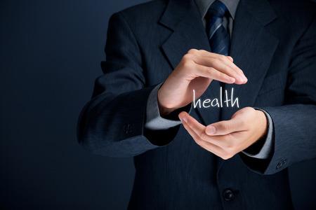 醫療保健: 醫療保健 - 保護健康的概念。醫療公司(醫療保險,健康診所)的商人做健康保護的姿態。