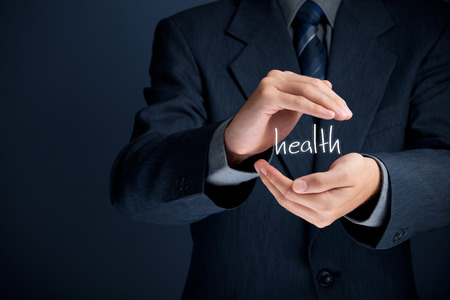 health service: Health care - protect health concept. Medical company (medical insurance, wellness clinic) businessman does protective gesture of health. Stock Photo