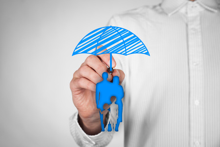 insurance policy: Family life insurance, family services and family policy concepts. Insurance agent draw umbrella (insurance symbol) above family icon. Stock Photo