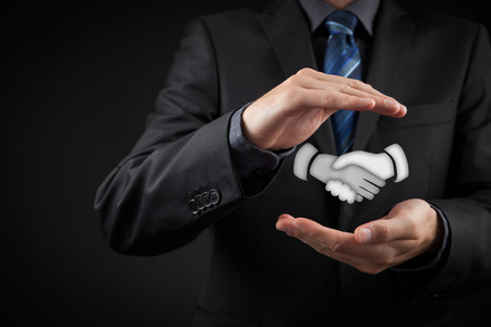 protection hands: Business cooperation and contract concept. Protecting business concept.