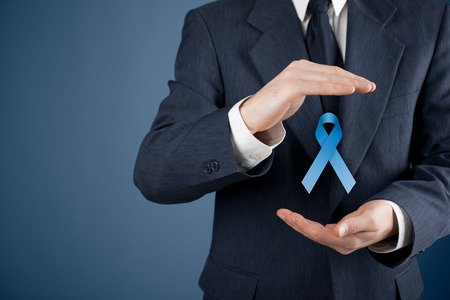 cure prevention: Prostate cancer awareness, peace and genetic disorder awareness - man with protective and support gesture and blue ribbon.