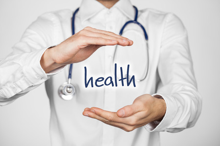 health symbols metaphors: Protect health concept. Doctor with protective gesture and text health.
