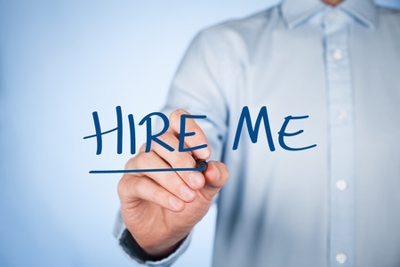 looking for a job: Hire me, give me a job, find a job, looking for a job concepts. Businessman write text hire me. Stock Photo