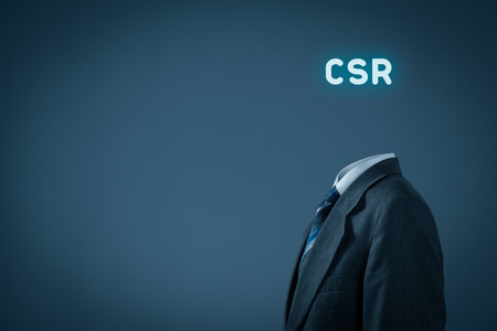 corporate responsibility: Corporate social responsibility (CSR) concept. Businessman think about CSR, manager with text CSR instead the head.