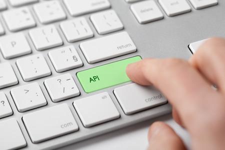 protocols: API (Application programming interface) concept - programmer click on keypad API on keyboard. Stock Photo