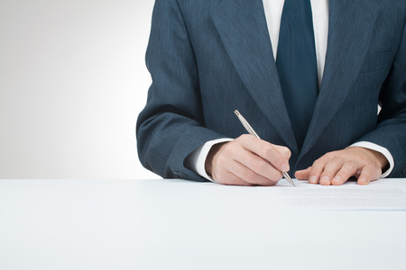 underwrite: Businessman sign contract, agreement, mortgage, insurance or another document
