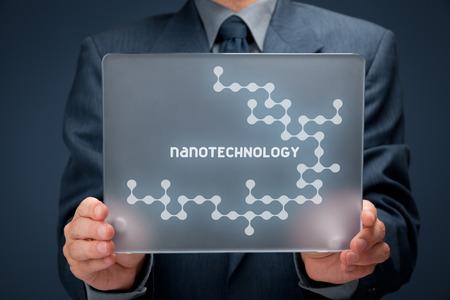 nanotechnology: Nanotechnology concept. Man holding futuristic tablet pc with nanotechnology design.