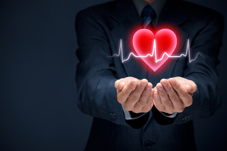 health symbols metaphors: Cardiology, protect health (healthcare) and heart problems prevention concept. Cardiologist with help gesture and symbol of heart and ECG heartbeat.