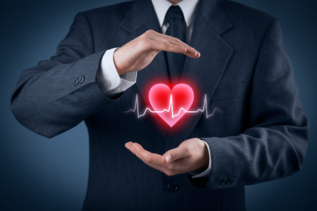 protect: Protect health (healthcare) and heart problems prevention (cardiology) concept. Cardiologist with protective gesture and symbol of heart and ECG heartbeat. Stock Photo