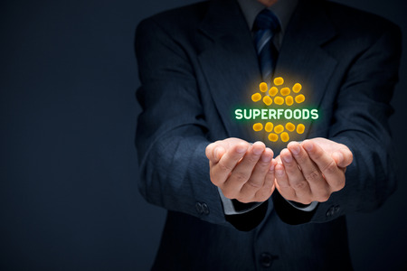 superfood: Businessman offer and protect superfoods seeds. Business with superfood is growing. Stock Photo