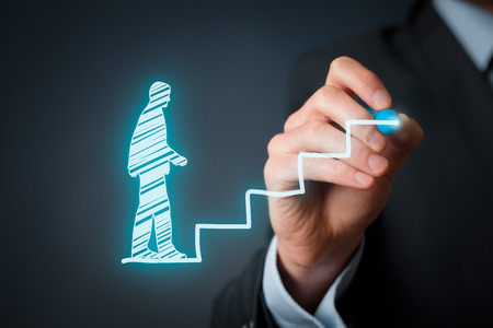 Personal development, personal and career growth, success, progress and potential concepts. Coach (human resources officer, supervisor) help employee with his growth symbolized by stairs. Stock Photo