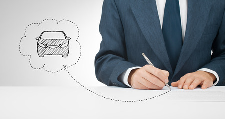 agreements: Sign car insurance, leasing or rental agreement or another car related document. Stock Photo