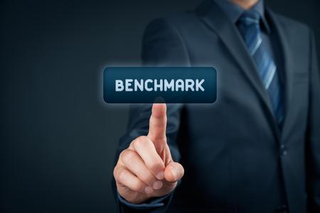 benchmark: Benchmark concept. Businessman click on virtual button with text benchmark.
