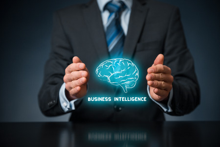 business decision: Business intelligence (BI) concept. Businessman with icon of brain and text business intelligence in protective gesture.