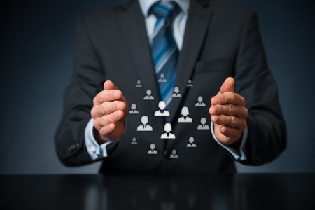team leader: Customer care, care for employees, labor union, life insurance, customer relationship management (CRM) and human resources concepts. Protective gesture of businessman or personnel and icons representing group of people. Stock Photo