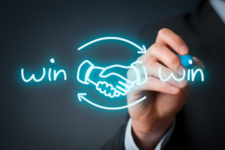 partnership strategy: Win-win partnership strategy concept. Businessman draw win-win scheme with handshake partnership agreement.