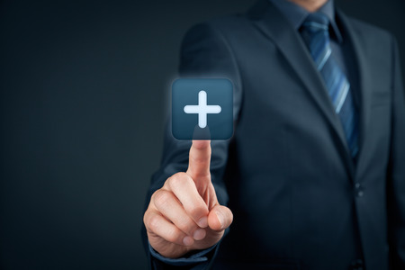 Businessman click on plus button, symbol of positive thing (like benefits, personal development, social networking). photo