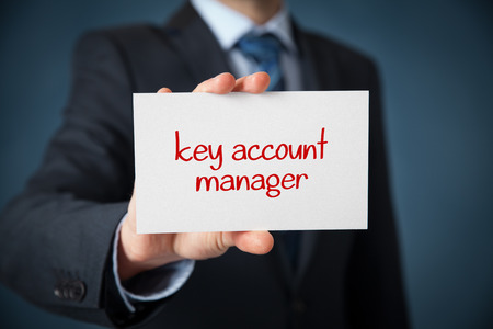 account executive: Key account manager advertisement concept. Man show card with text key account manager.