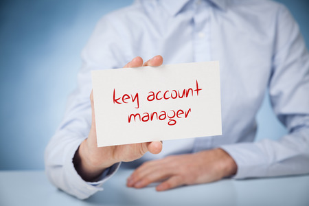 advertising network: Key account manager advertisement concept. Man show card with text key account manager.