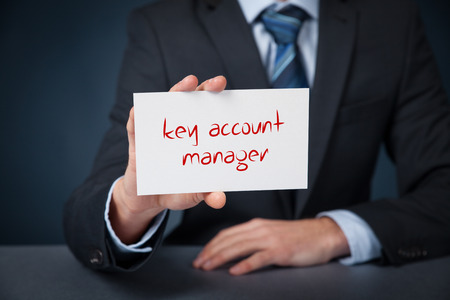 sales executive: Key account manager advertisement concept. Man show card with text key account manager.