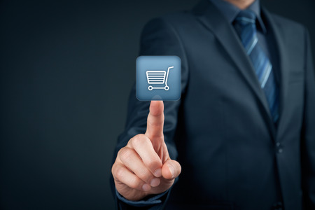 eshop: Businessman click on virtual e-shop button with shopping cart. E-commerce and B2C concept. Stock Photo
