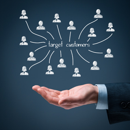 Target customers concept. Man hold target customers scheme in hand. Imagens - 37982072