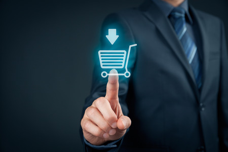 Businessman click on virtual e-shop button with shopping cart. E-commerce and B2C, man buy or download online concept.