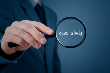 case: Businessman focused on case study. Businessman enlarge handwritten text case study.