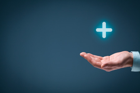 Businessman offer positive thing (like benefits, personal development, social networking) represented by plus sign. Composition with blank space on left.
