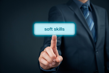 skills: Soft skills - businessman click on button to purchase soft skills training. Stock Photo
