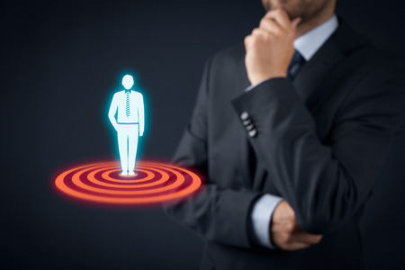 target business: Target customer (marketing) concept. Businessman think about target customer represented by virtual icon of man standing on target.