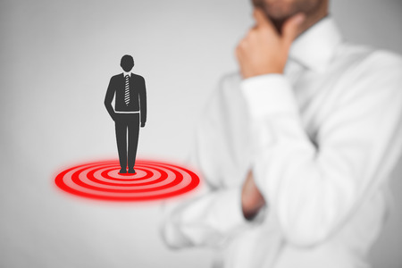 customer care: Target customer (marketing) concept. Businessman think about target customer represented by virtual icon of man standing on target.