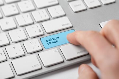 supervise: Customer service concept. Manager click on customer service keypad.