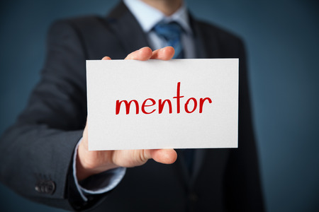 personal development: Mentor advertisement concept. Man show card with text mentor. Stock Photo